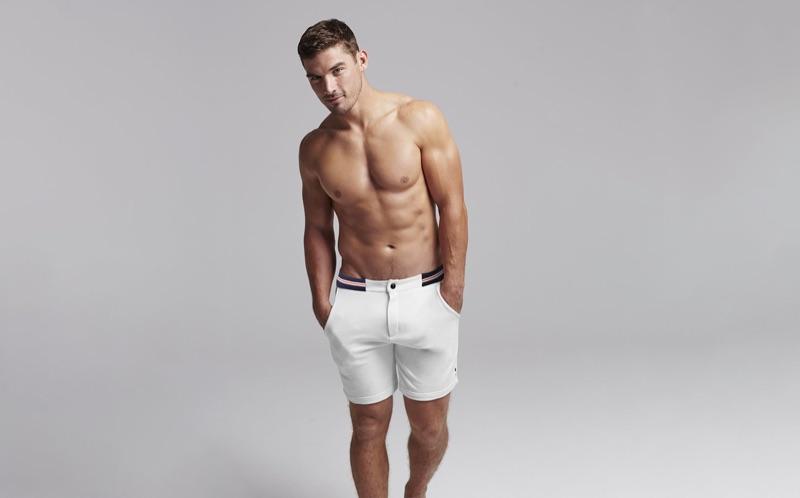 Taking to the studio, Kerry Degman rocks white shorts from Ron Dorff.