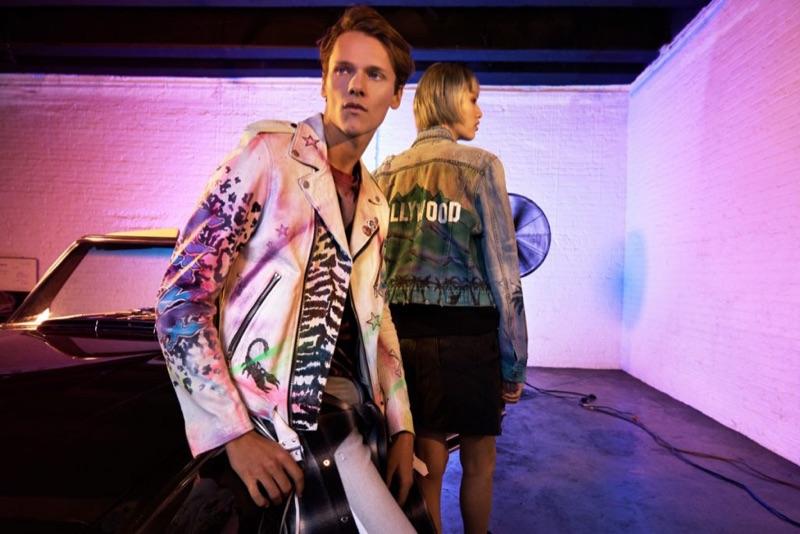 Model Ryan Keating wears an AMIRI airbrushed leather jacket.