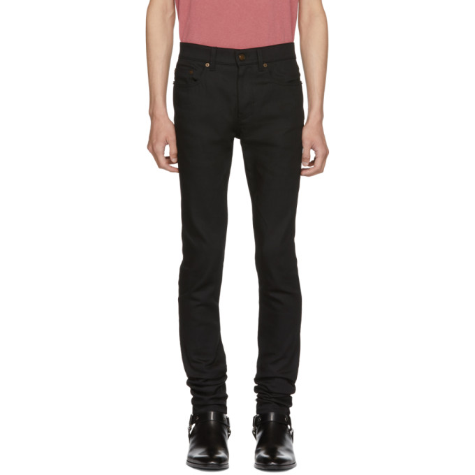 771c7fbd3c0 Saint Laurent Black Raw Low-Rise Skinny Jeans | The Fashionisto