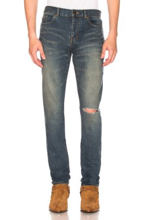 Saint Laurent Low Rise Destroyed Skinny Jeans in Blue. - size 28 (also in 36)