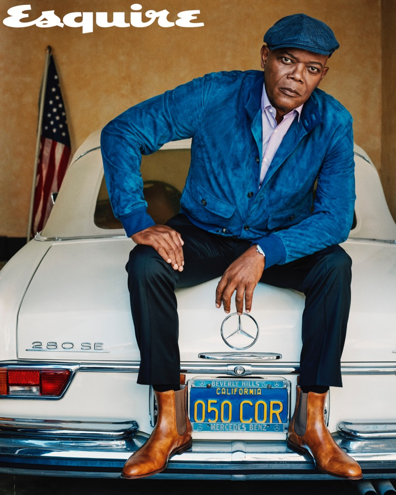 A sharp vision, Samuel L. Jackson sports a Loro Piana jacket with a shirt and trousers by BOSS. Christian Louboutin boots and a Brunello Cucinelli hat complete his look.