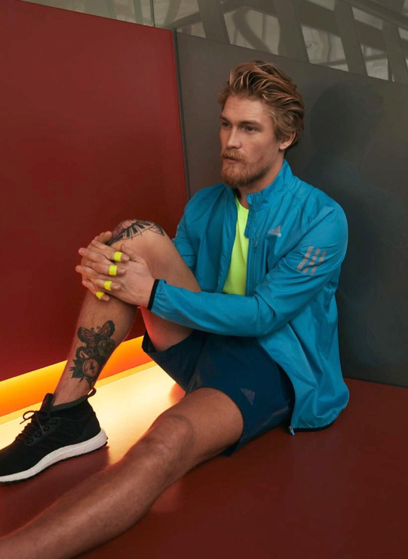 Making a colorful statement in activewear, Harry Goodwins sports Adidas.