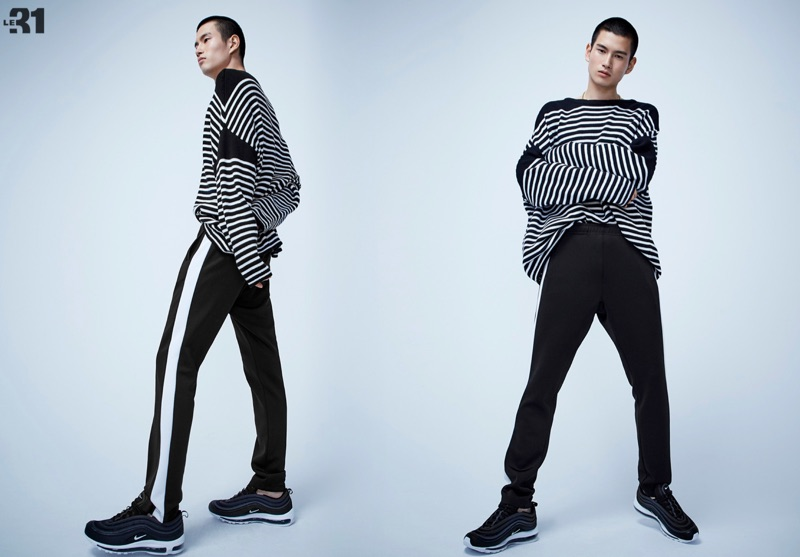Making a case for stripes, Kohei Takabatake wears a LE 31 loose striped knit sweater with retro track pants and Nike Air Max 97 sneakers.