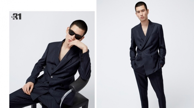 Dashing to say the least, Kohei Takabatake models a pinstripe anti-fit suit from LE 31.