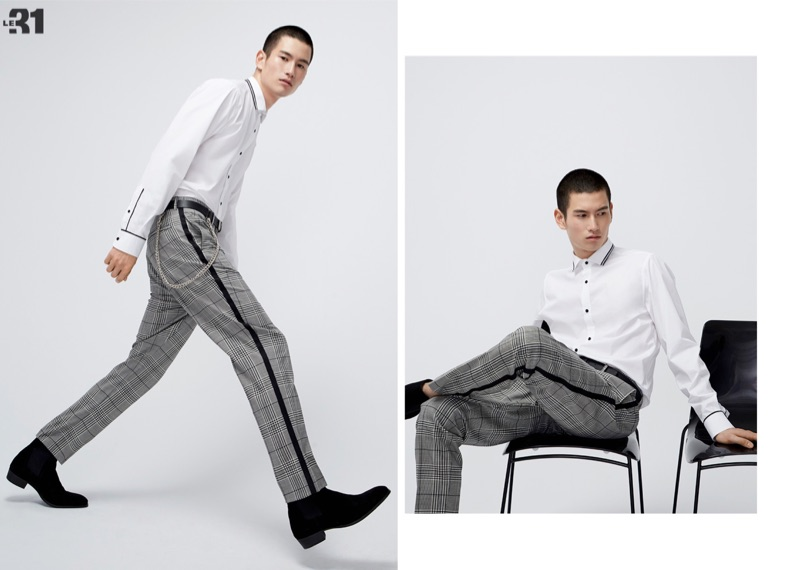 A sharp but contemporary vision, Kohei Takabatake sports a LE 31 athletic trim white shirt and contrast stripe Prince of Wales pants.
