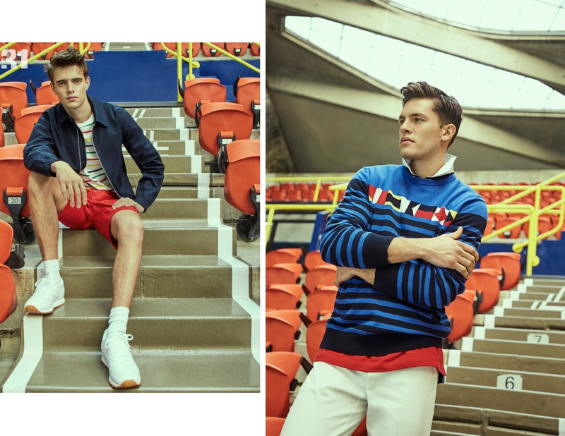 Left: Jordy Baan wears a LE 31 Harrington jacket, striped boat tee, and red Bermudas with Reebok Classic sneakers. Right: Simon Malenfant dons a LE 31 nautical flag sweater and colorblock polo shirt.