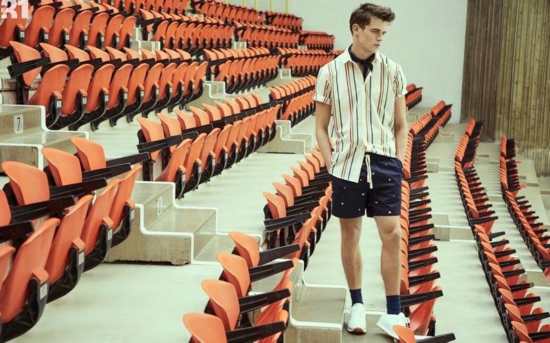 Model Jordy Baan wears a LE 31 striped shirt, shorts, and paisley bandana.
