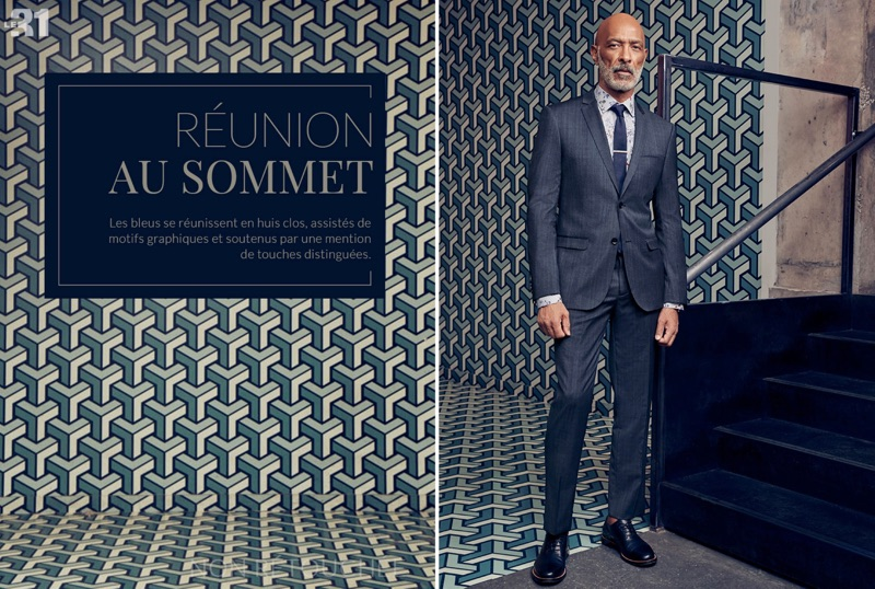 Lono Brazil is a sartorial vision in a LE 31 chambray check suit and knit tie.
