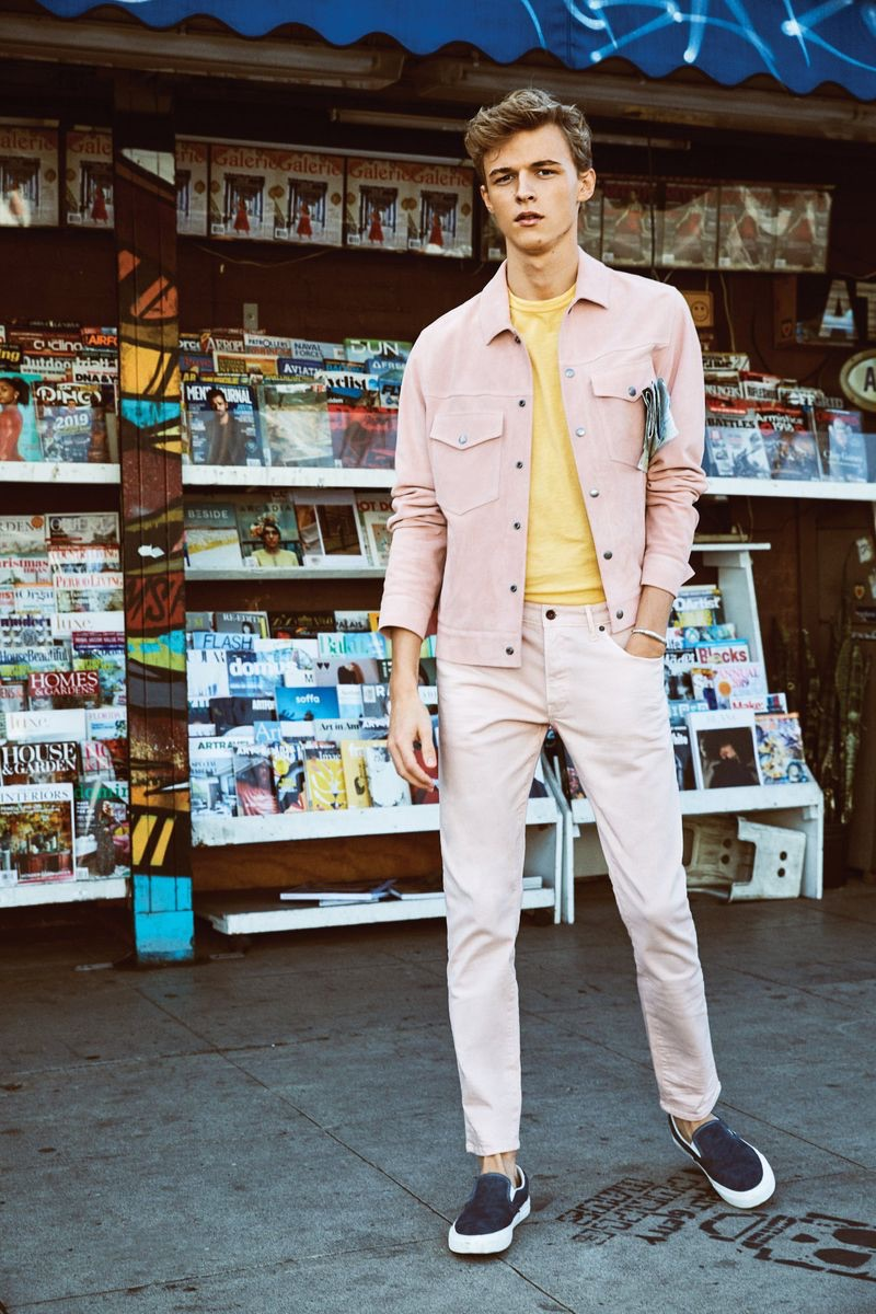 Stepping out in spring style, Max Barczak wears a Todd Snyder pink jacket, 5-pocket stretch twill pants, and a yellow Todd Snyder + Champion sweatshirt.