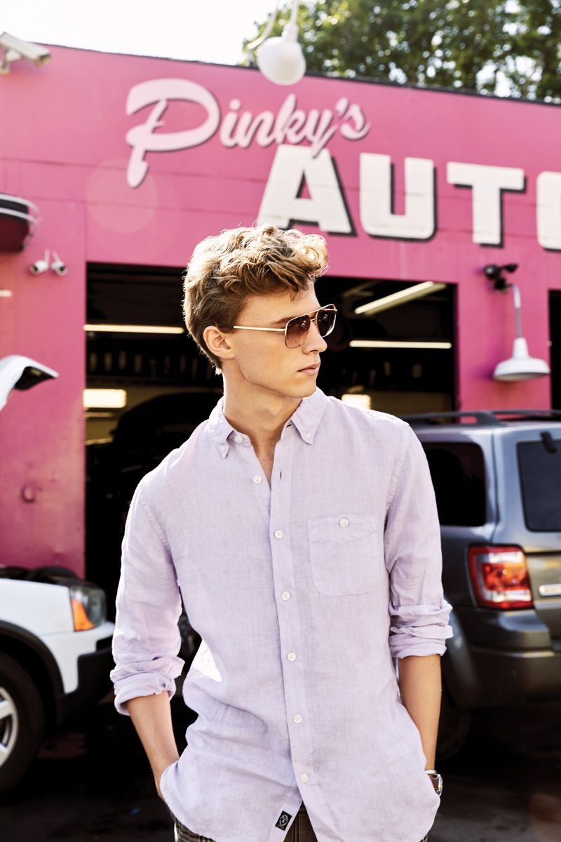 Max Barczak wears a lavender button-down linen shirt from Todd Snyder.
