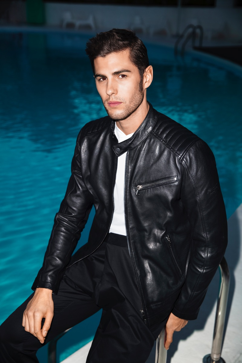 Appearing poolside, René Grincourt rocks a leather jacket for Wormland's spring-summer 2019 campaign.