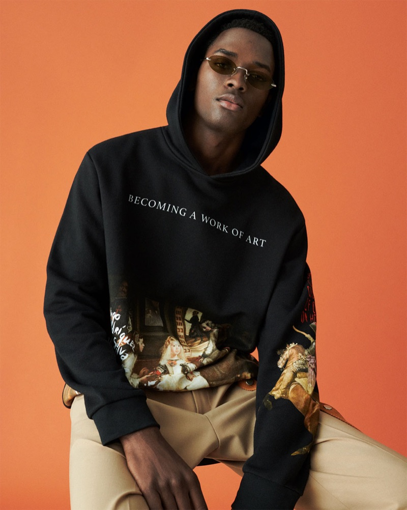 Model Daniel Morel sports a hoodie from Zara Man's Work of Art collection.