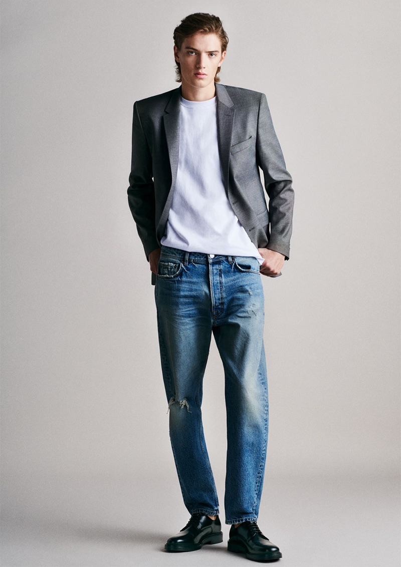 Theo Ford sports a blazer with a simple tee and distressed jeans by Zara Man.