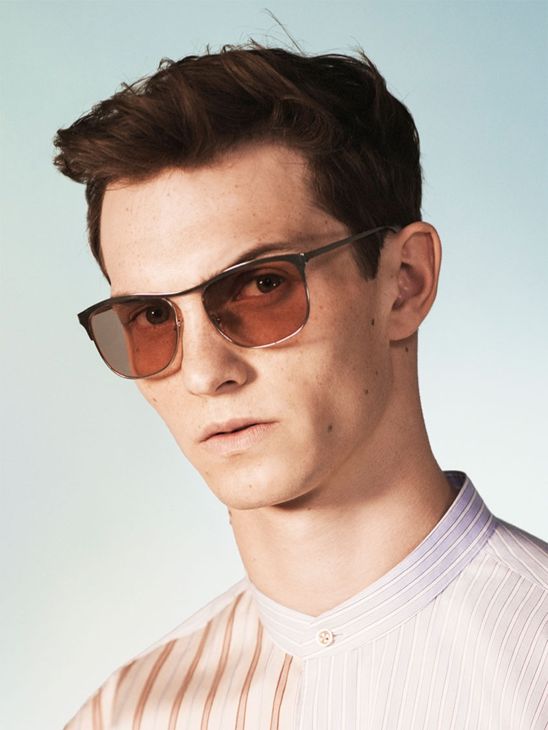 A cool vision, Luc Defont-Saviard sports sunglasses and a band-collar shirt from Zara's spring-summer 2019 studio collection.