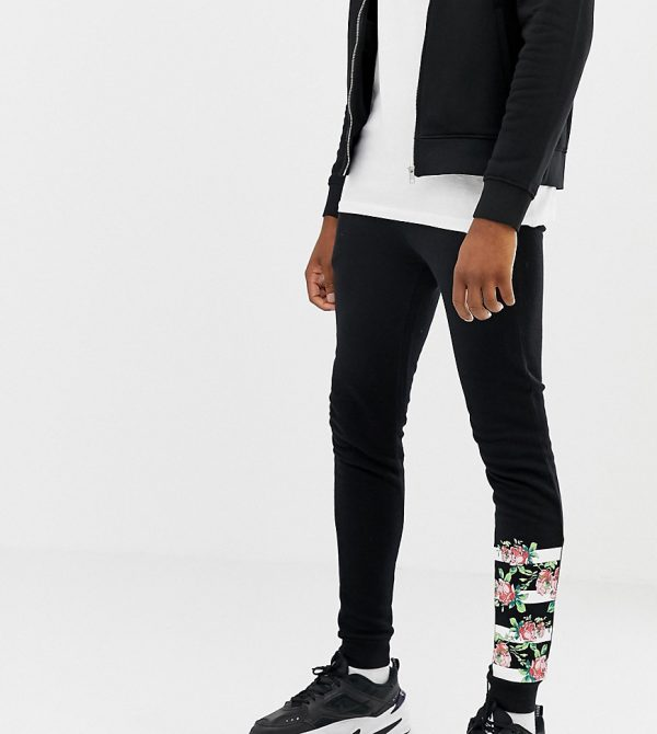 ASOS DESIGN Tall super skinny sweatpants with rose gold zip pockets and print - Black