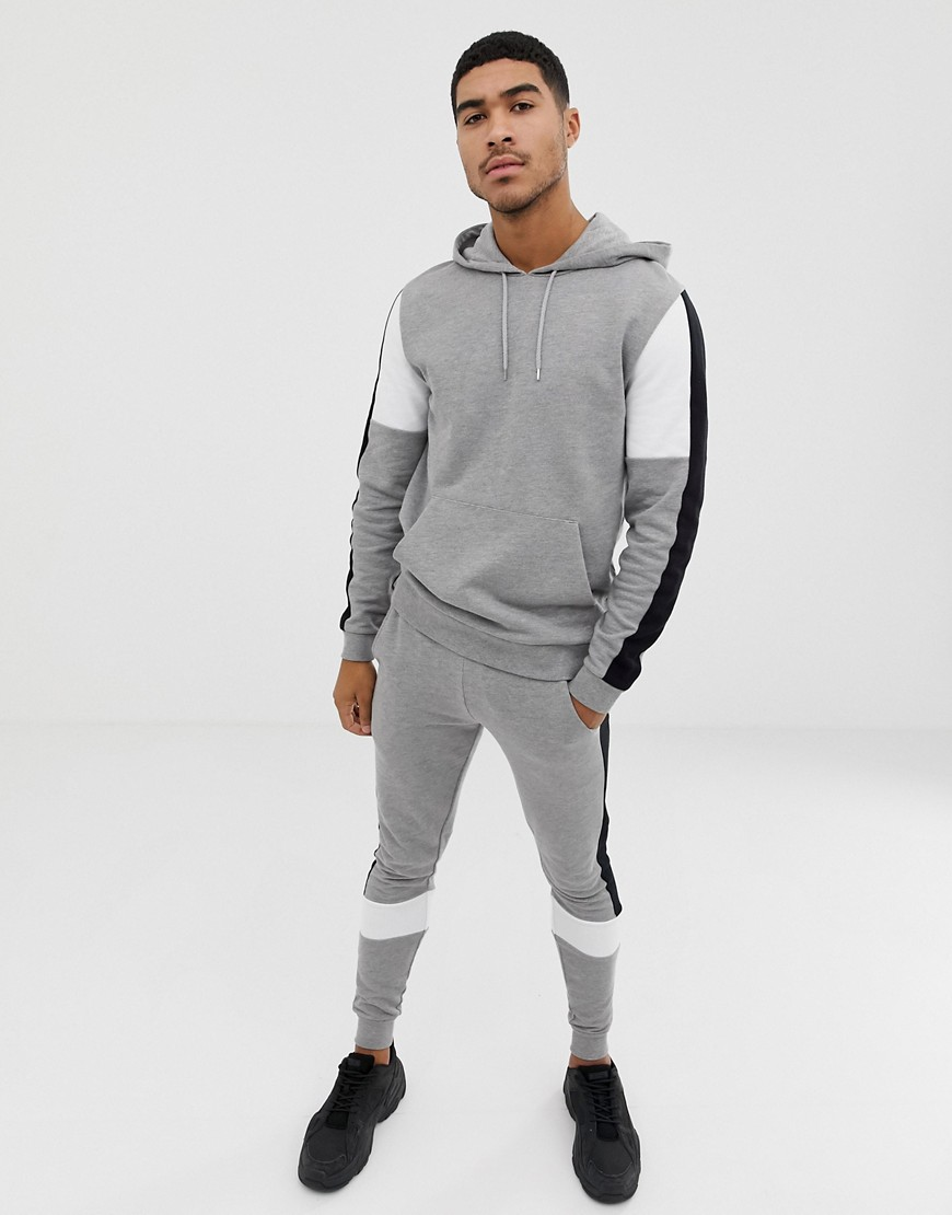 8811dfc4 ASOS DESIGN tracksuit hoodie/super skinny sweatpants with color blocking  and side stripe in gray marl - Gray