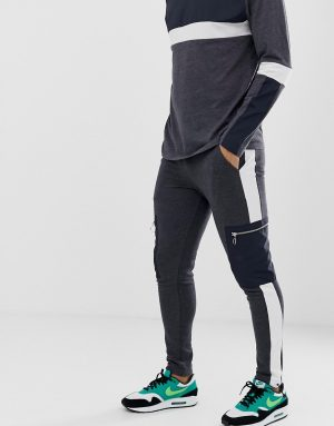ASOS DESIGN two-piece skinny sweatpants with side stripe and woven cargo pocket in charcoal - Gray
