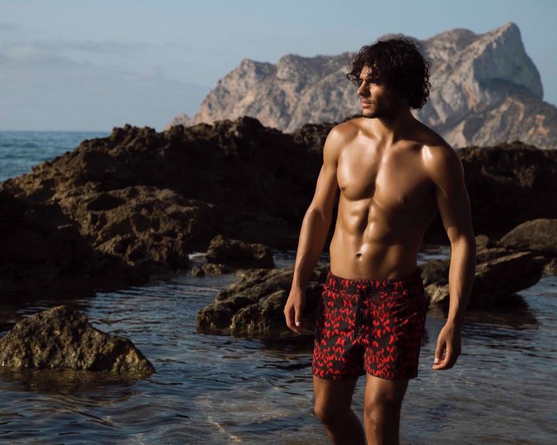 Model Matteo Cupelli appears in Azzaro Paris' spring-summer 2019 swimwear campaign.