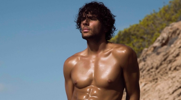 Azzaro Paris enlists model Matteo Cupelli as the star of its spring-summer 2019 swimwear campaign.