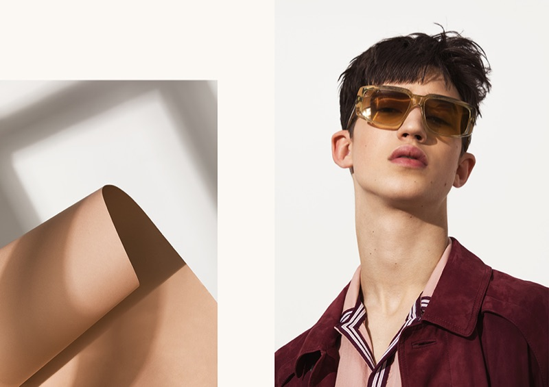 A cool vision, Fausto wears a suede coat, camp-collar shirt, and sunglasses by BOSS.