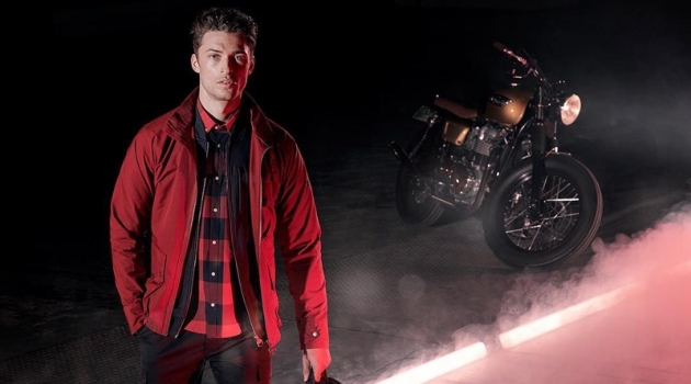 Harvey Haydon sports a red jacket from Barbour International's spring-summer 2019 collection.