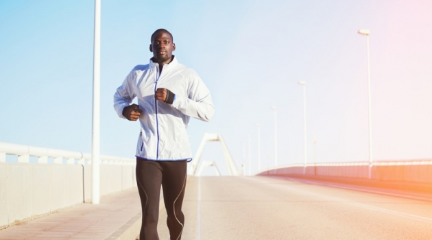 Black Man in Workout Clothes Running on Bridge