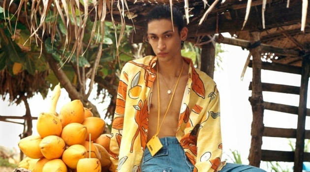 Embracing a tropical flair, Sami Younis wears a shirt, jeans, and card wallet by Jacquemus for Browns' spring-summer 2019 campaign. He also sports Rick Owens x Birkenstock sandals.