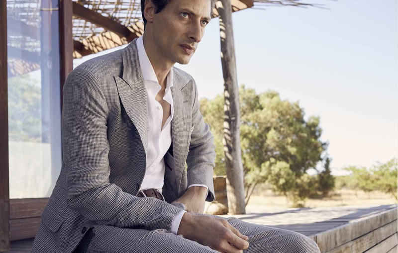 Model Jonas Mason sports a Brunello Cucinelli sport jacket and trousers with a solid woven shirt.