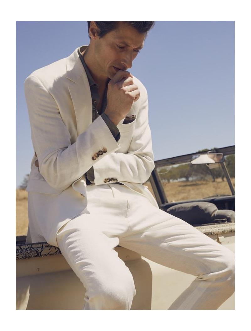 A sleek vision, Jonas Mason models a Chevron linen Panama suit from Brunello Cucinelli.