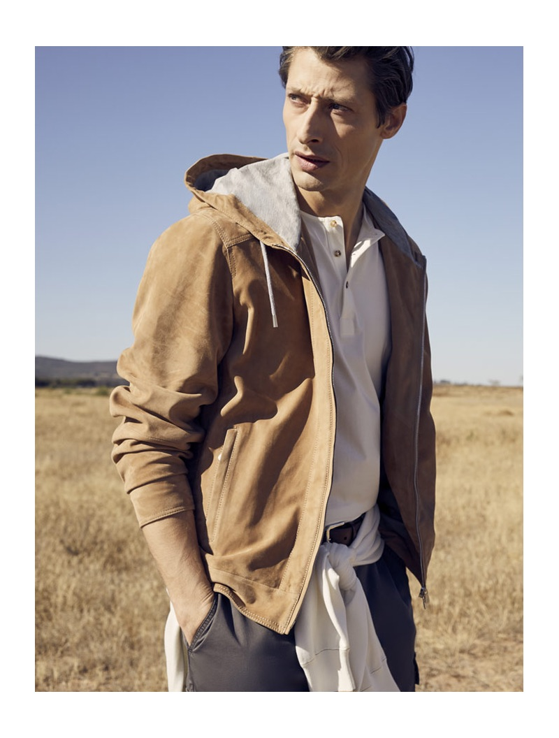 Pictured outdoors, Jonas Mason wears a Brunello Cucinelli two-way zip suede hoodie and cargo pants.