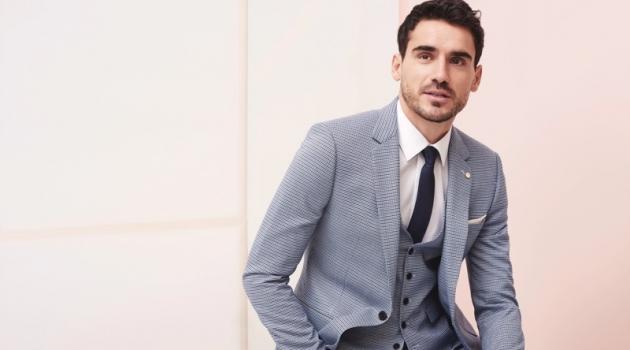Donning a grey suit, Arthur Kulkov fronts Burton's spring-summer 2019 campaign.