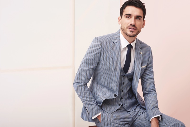 Donning a grey suit, Arthur Kulkov fronts Burton's spring-summer 2019 campaign.