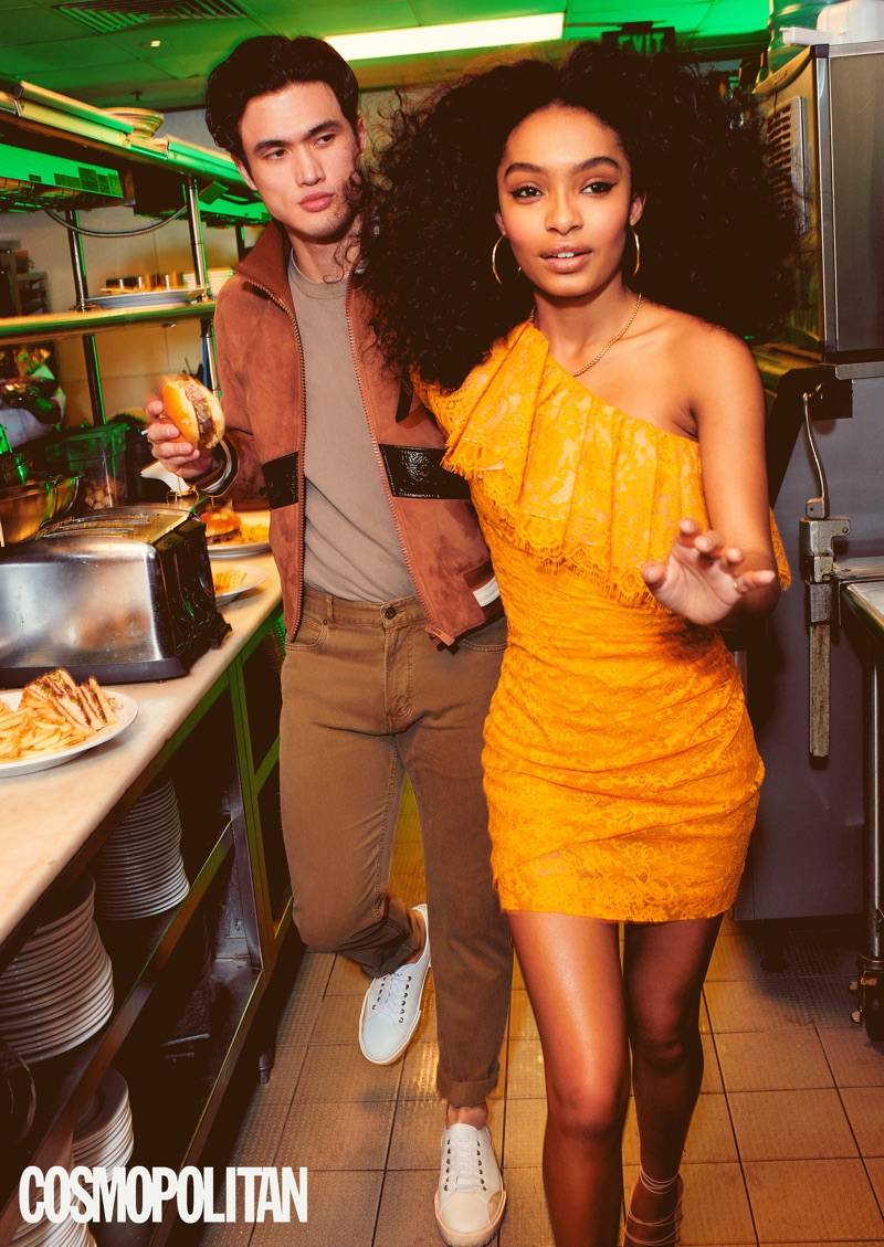 Eric Ray Davidson photographs Charles Melton and Yara Shahidi. Melton wears a Bally jacket and sneakers. He also sports a John Elliott t-shirt and Billy Reid pants.
