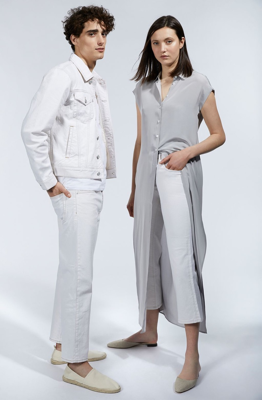 Clad in white, Kane Roberts wears a Club Monaco denim jacket, pocket crew, cropped straight denim jeans, and espadrilles.