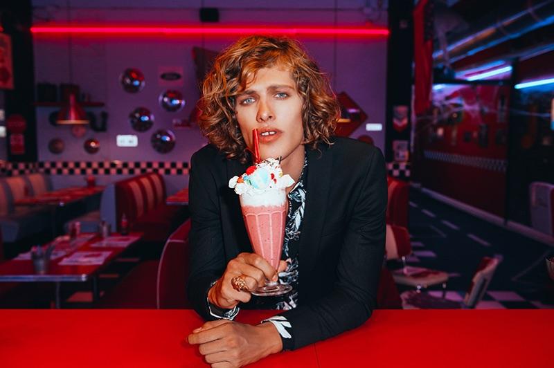 Enjoying a milkshake, Umberto Manca fronts David Naman's spring-summer 2019 campaign.
