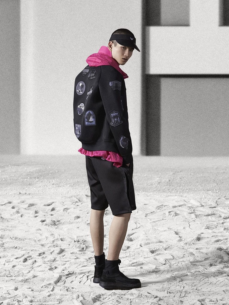 Going sporty, Kohei Takabatake wears a black and pink look by Emporio Armani.