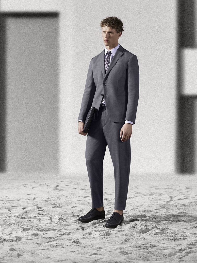 Front and center, Bram Valbracht dons an Emporio Armani suit.