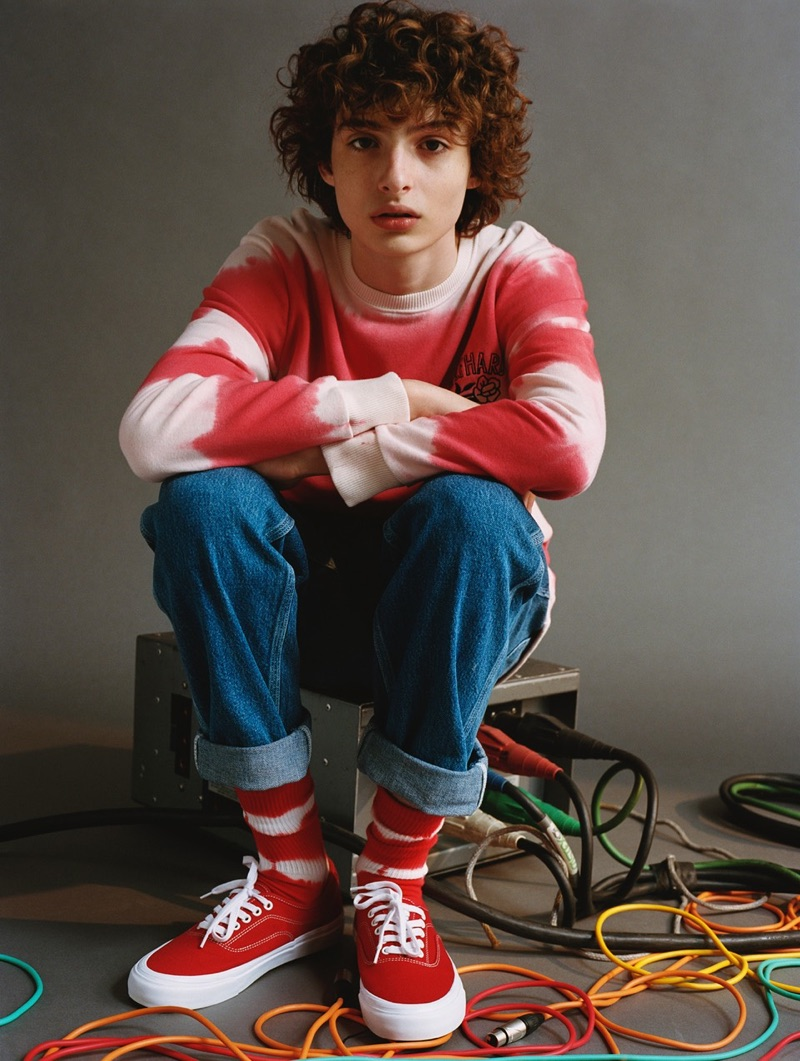 Finn Wolfhard sports a red and white tie-dye  sweatshirt from his Pull & Bear collaboration.
