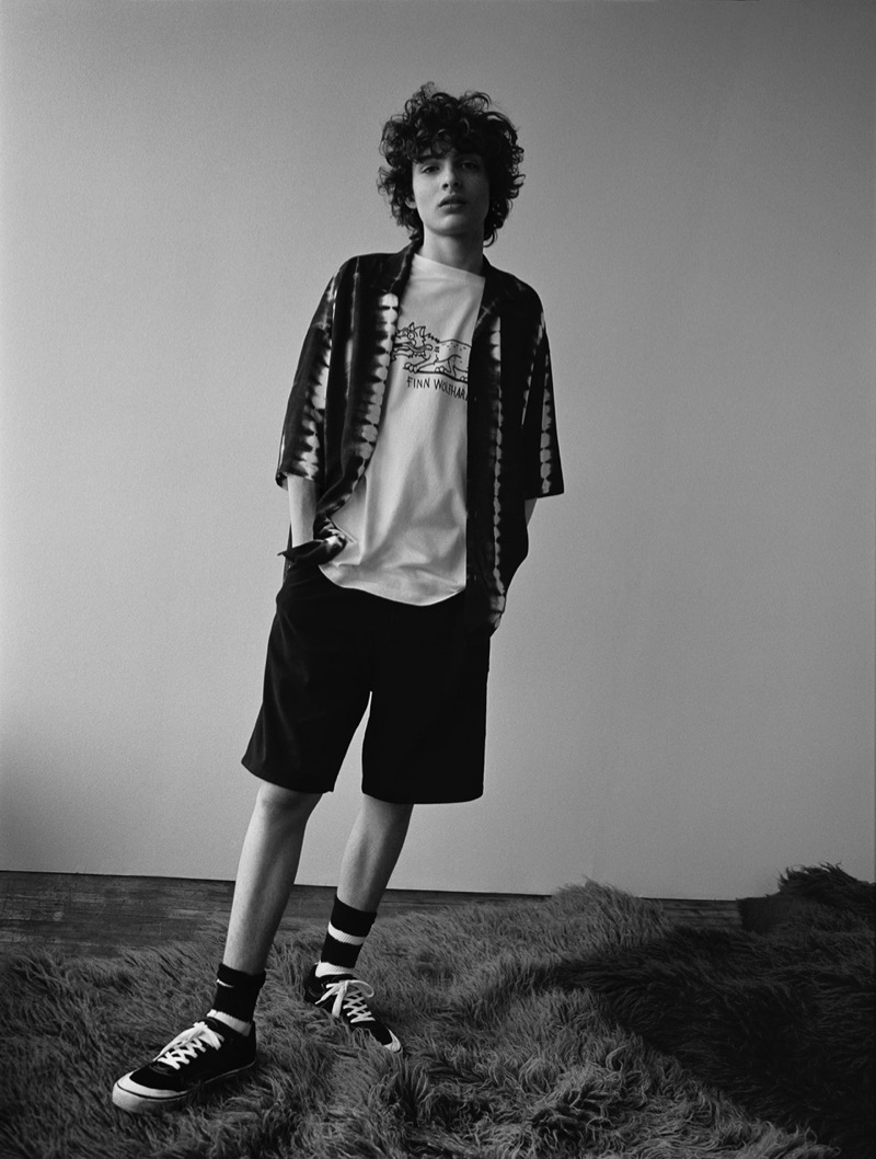 Appearing in a black and white photo, Finn Wolfhard rocks a look from his Pull & Bear capsule collection.