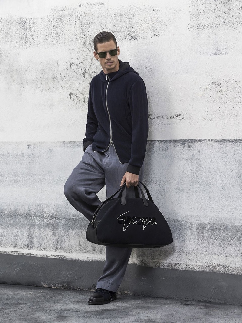 Mark Cox dons a sleek look from Giorgio Armani's spring-summer 2019 collection.