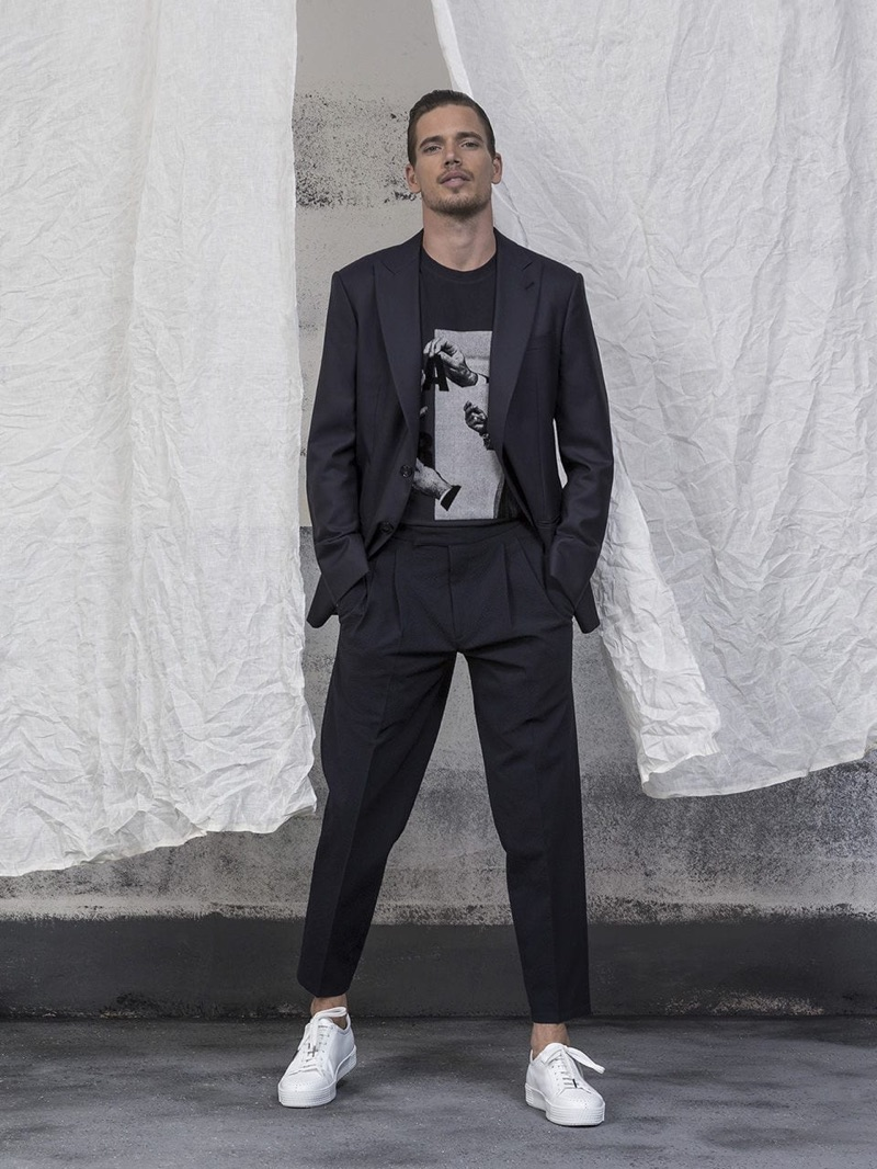Model Mark Cox sports a Giorgio Armani suit with a tee and sneakers.