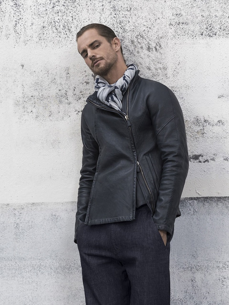 Maxime Daunay sports a leather jacket and trousers from Giorgio Armani.