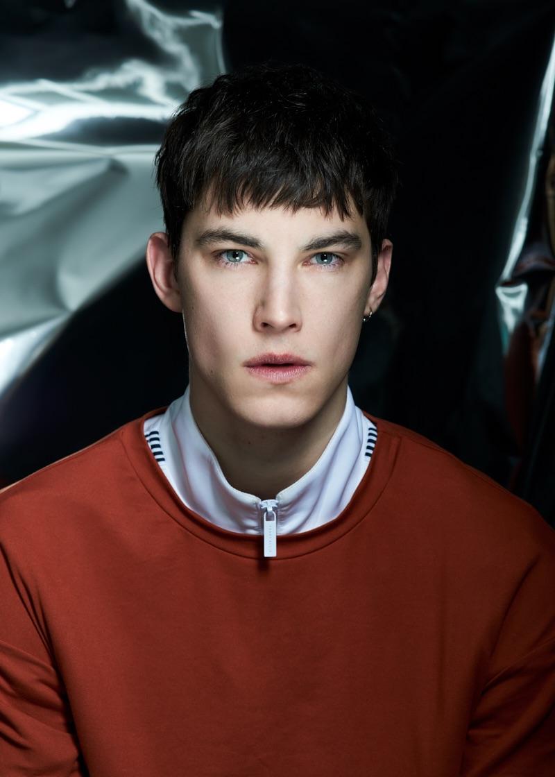 Julian wears top Oak and track jacket Perry Ellis.