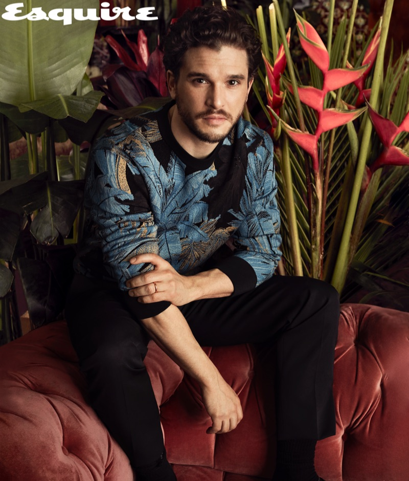 Actor Kit Harington wears a sweater and trousers by Salvatore Ferragamo.