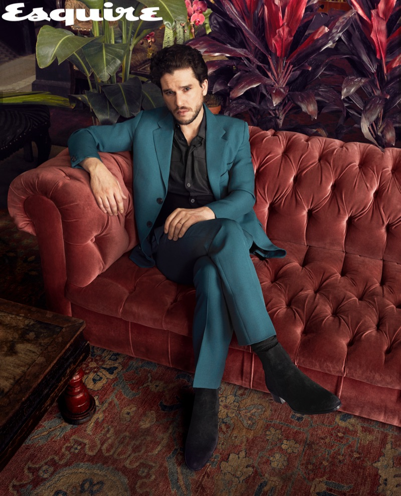 A sleek vision, Kit Harington dons a suit and shirt by Givenchy with Barbanera boots.