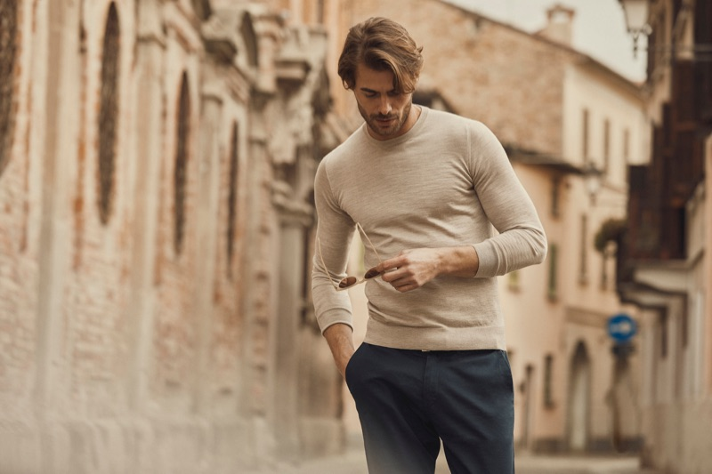 A casual but smart vision, Jacey Elthalion wears a fine-silk cashmere crewneck by Luca Faloni.