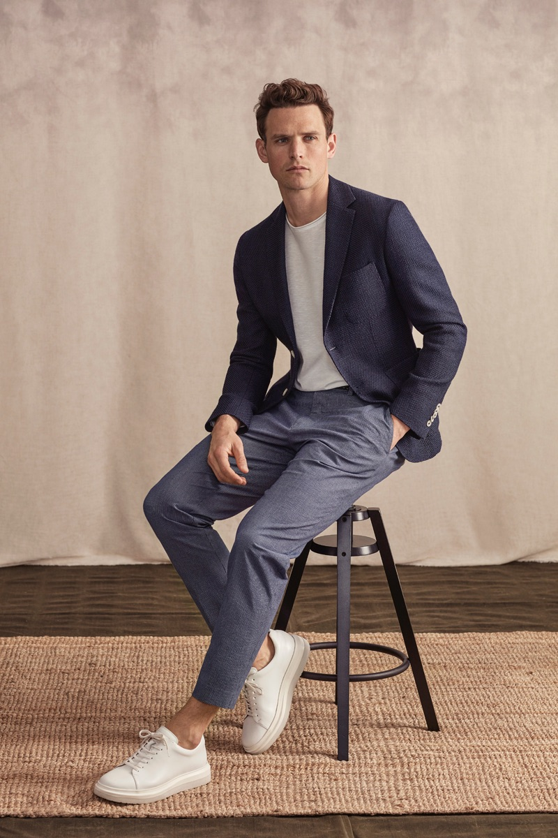Front and center, Guy Robinson sports a sleek ensemble from Lufian's spring-summer 2019 lineup.