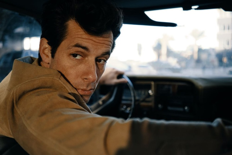 Taking a ride, Mark Ronson rocks a suede overshirt by Neighborhood.