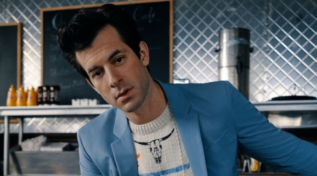 Front and center, Mark Ronson sports a light blue Prada suit with a Saint Laurent sweater.