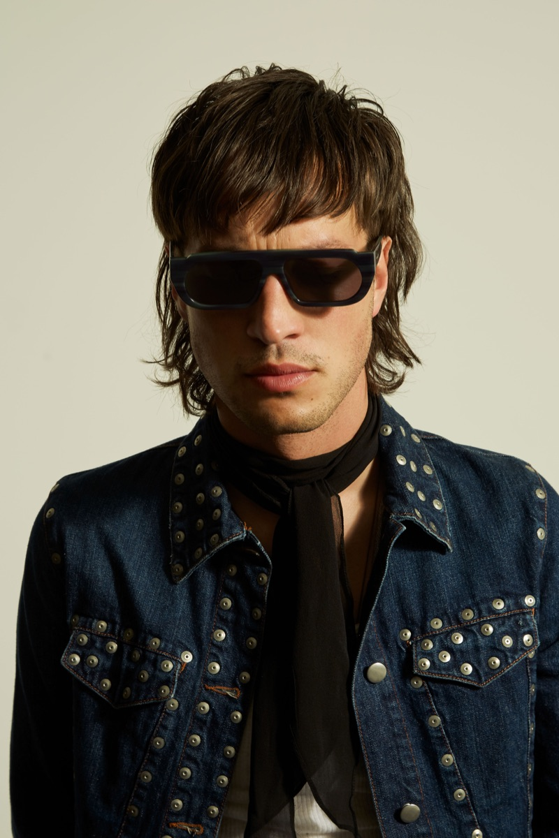 Karen Walker taps Marlon Williams to appear in its Monumental collection. He wears the brand's Turing sunglasses.